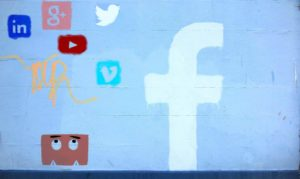 Social Media Graffitti at wall of house in Wood Quay in Galway