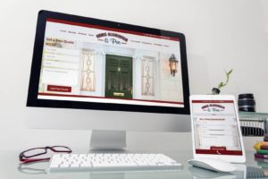 Ennis Aluminium website on screen and tablet